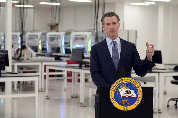 Newsom orders California check in time as Covid cases flood